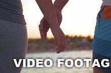 Couple walking outdoor holding hands