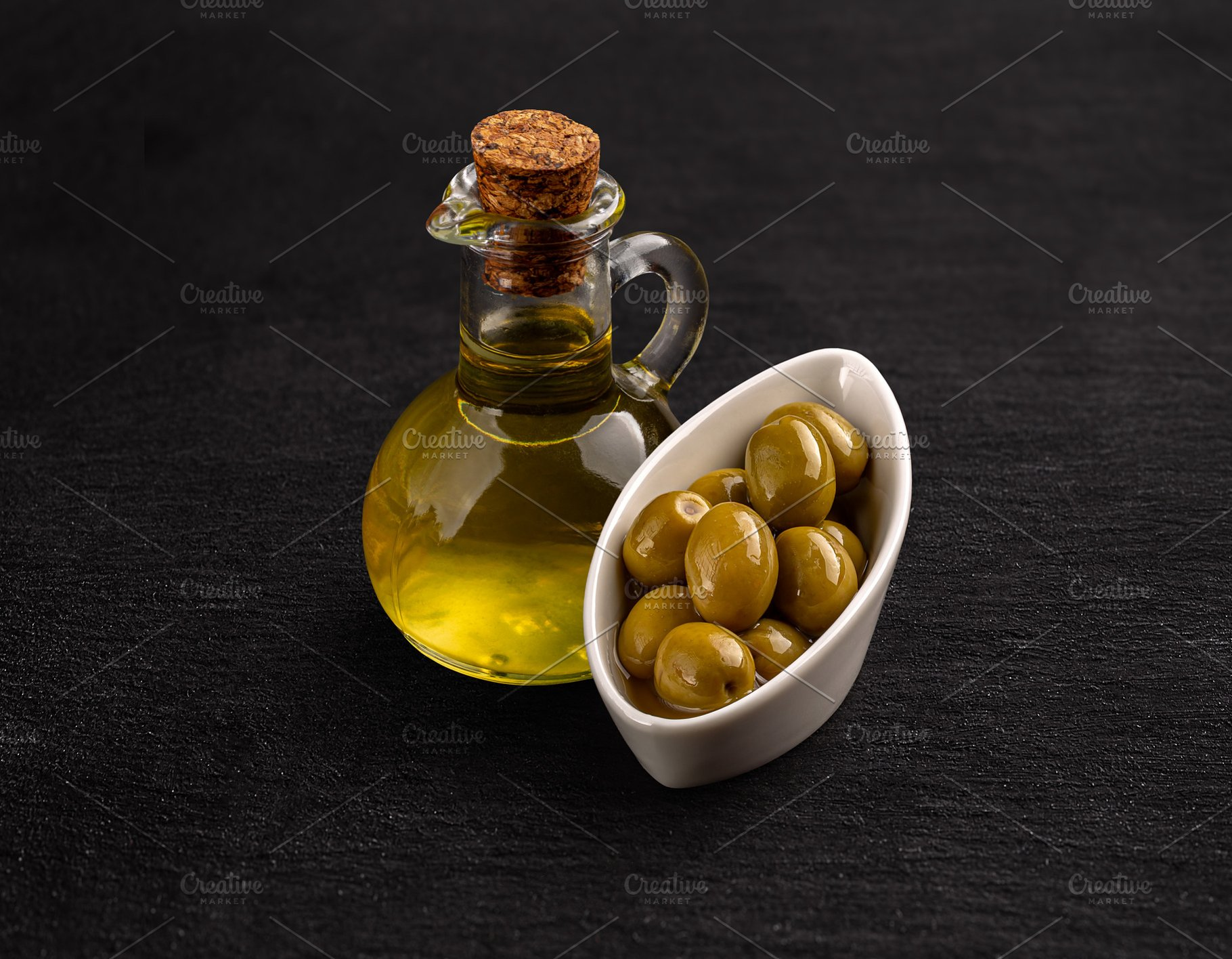 Olive oil and green olive seeds