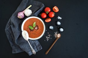 Gazpacho soup in rustic metal bowl