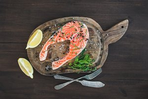 Raw salmon steak with fresh herbs