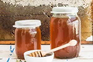 Jars of honey with honeycombs