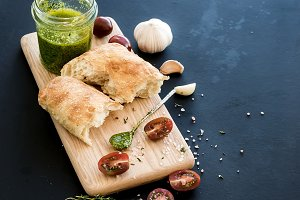 Pesto sauce in jar & ciabatta bread