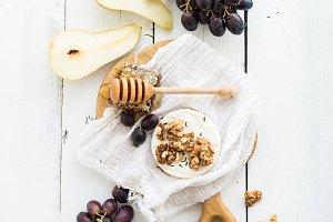 Camembert cheese, grape and walnuts