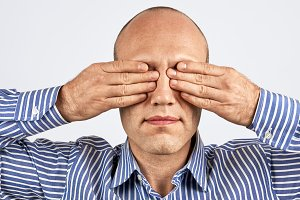 Man with eyes tightly closed