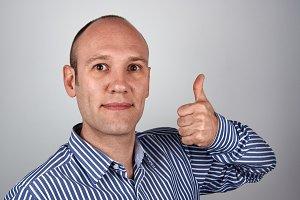 Man shows thumb up