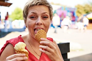 Pretty blond woman with ice cream