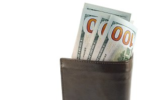 100 dollar bills in leather wallet