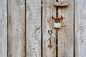 Wooden bar door with padlock