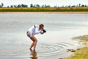 Girl taking photo in water