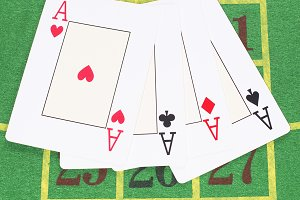 Four cards on green carpet