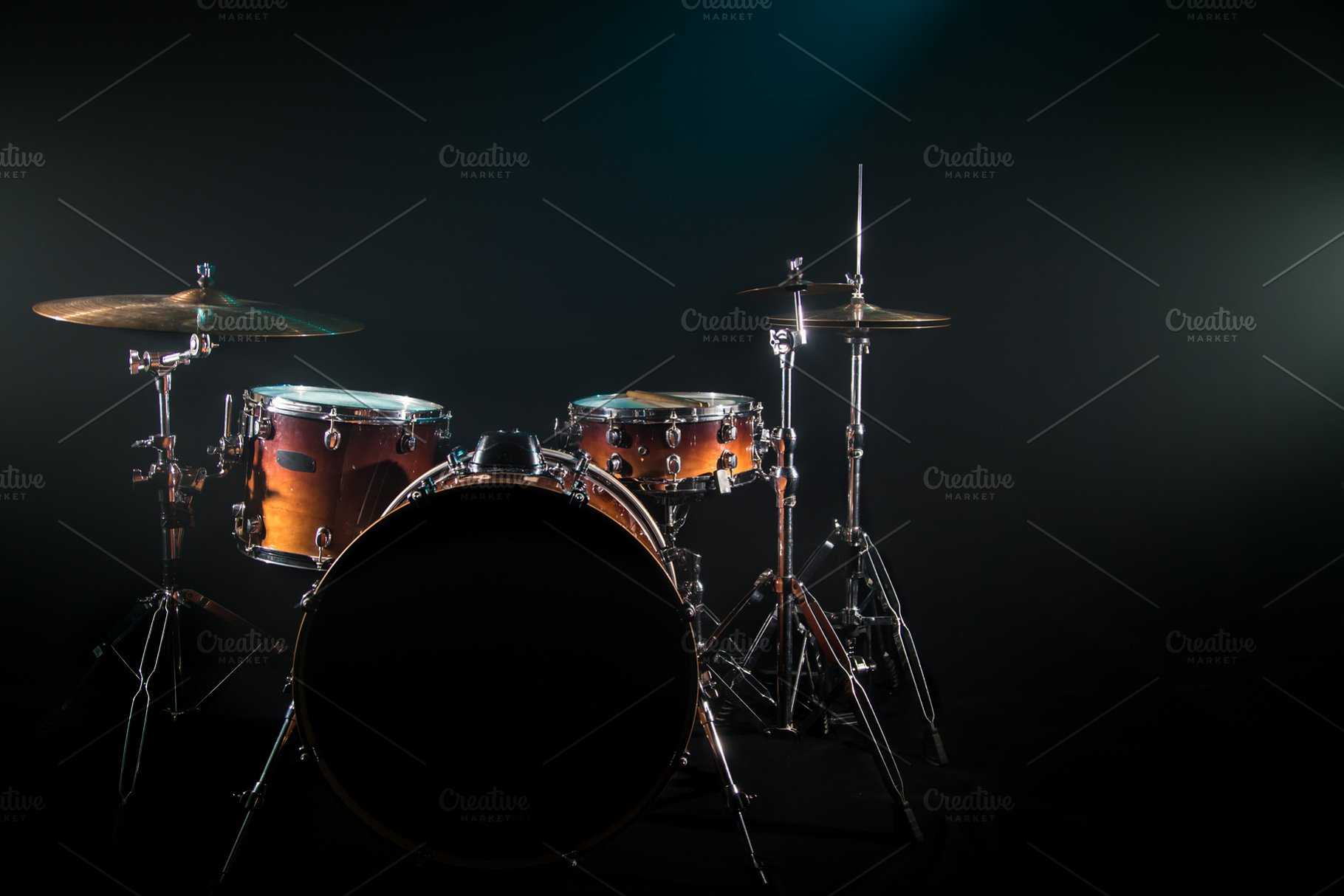 drum set on a black background with