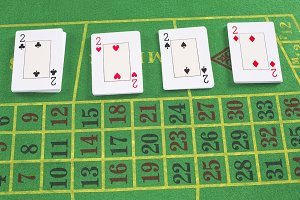 Deck of cards on green carpet