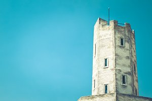 Old white tower with blue sky