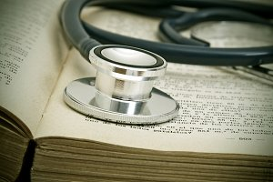 medical doctor stethoscope over book