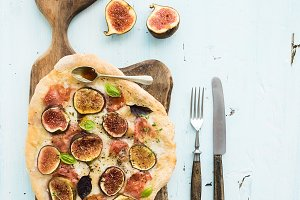 Rustic homemade pizza with figs