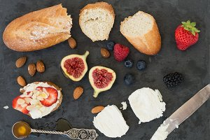 A set of bread, goat cheese & figs
