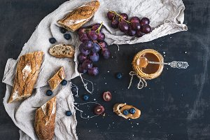French baguette with red grapes