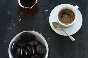 Cookies with cup and pot of coffee