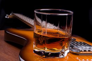 Glass of rum on guitar