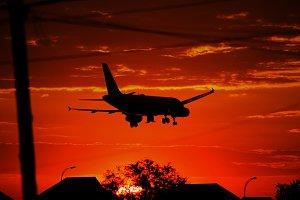 Sunset Landing Plane