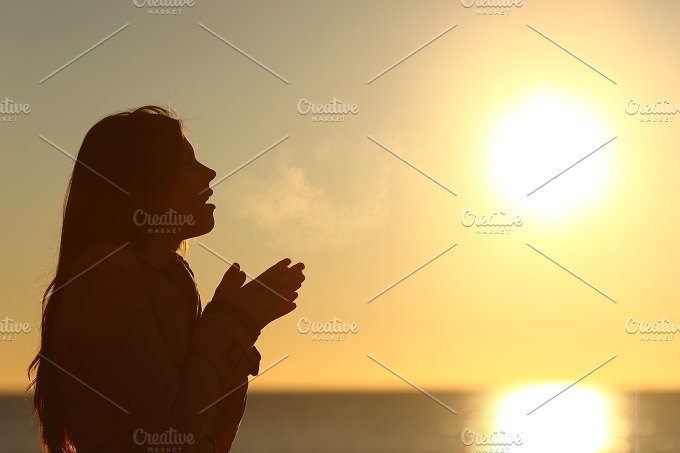 Woman silhouette breathing in a cold winter.jpg - People