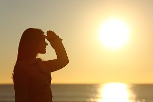 Silhouette of a woman looking forward at sunset.jpg