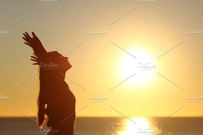 Woman breathing fresh air at sunset.jpg - Health