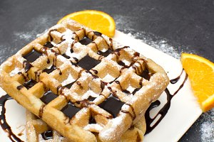 Waffles with chocolate and oranges
