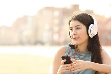 Candid girl listening music with a smartphone.jpg