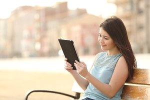 Teen student girl reading a tablet and learning.jpg