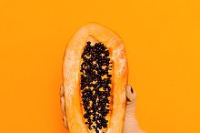 Fashion photo. arm with papaya fruit