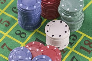 Poker chips on green carpet
