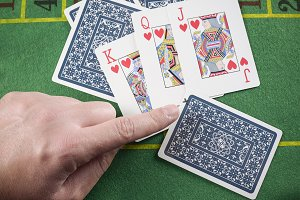 Finger pointing marked cards cheatin