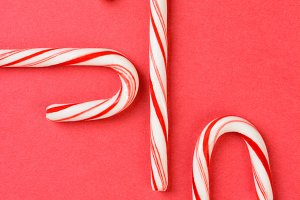 Three Candy  Canes on Red