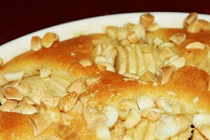Apple pie garnished with almonds