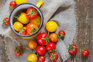 colorful tomatoes in a metal mug