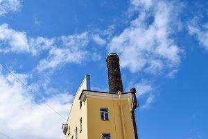 Yellow tower under blue skies.