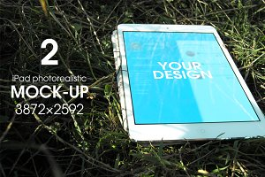 Mock-up laptop on the grass.