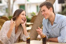 Couple dating and flirting in a restaurant.jpg