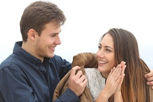 Couple falling in love with he covering her with his jacket.jpg