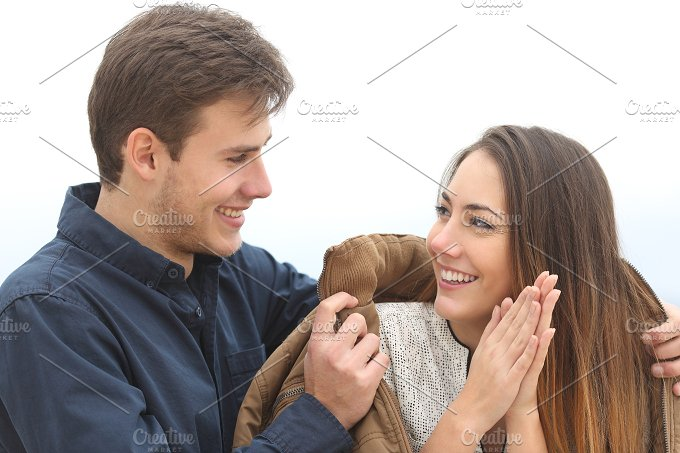 Couple falling in love with he covering her with his jacket.jpg - People