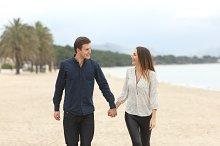Couple in love taking a walk on the beach.jpg
