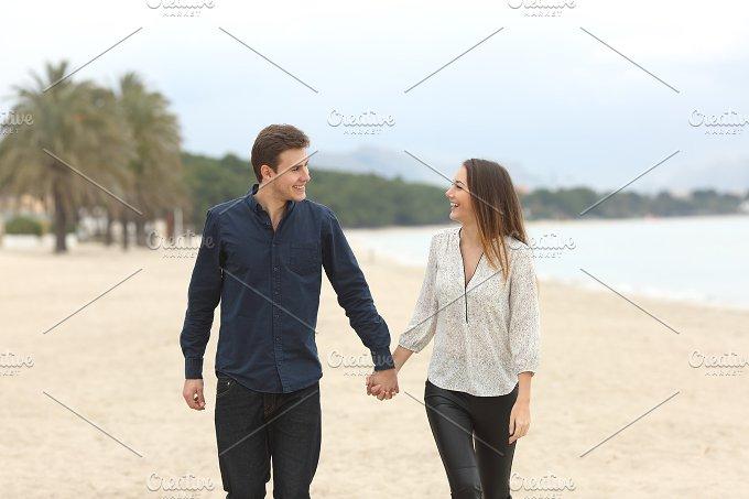 Couple in love taking a walk on the beach.jpg - People
