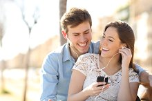 Couple listening to the music from a smart phone.jpg