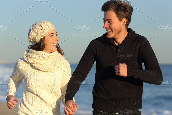Couple running on the beach in winter.jpg - People