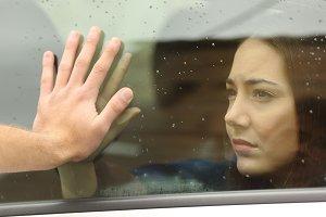 Couple saying goodbye before car travel.jpg