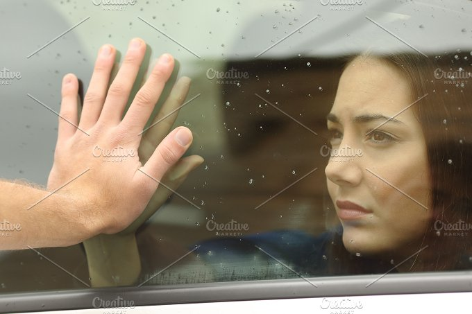 Couple saying goodbye before car travel.jpg - People