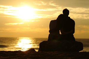 Couple silhouette watching sunset on the beach.jpg