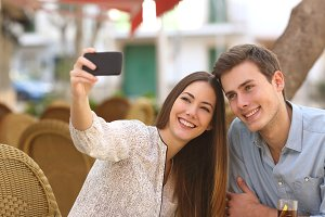 Couple taking a selfie photo in a restaurant.jpg