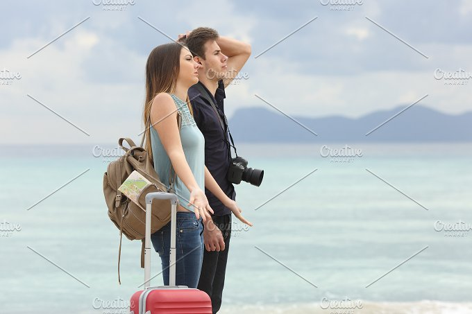 Tourists frustrated with the bad weather on the beach.jpg - Holidays